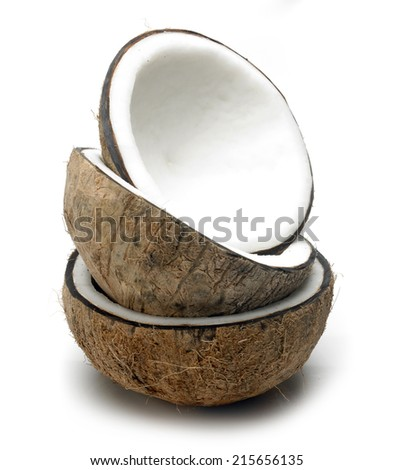Triple coconut cut in half on white background  - stock photo