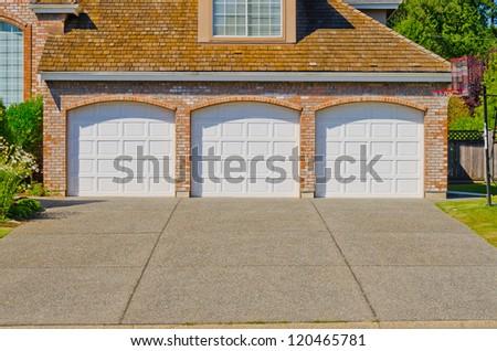 Triple doors garage. - stock photo