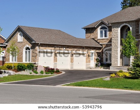 Triple garage with nice landscaping