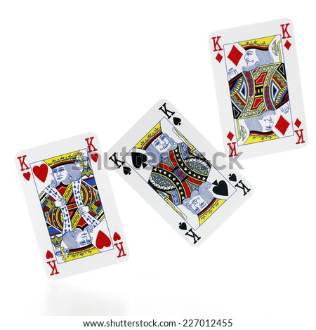 Triple King (poker cards) isolated on white background - stock photo