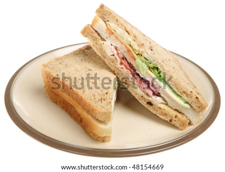 Triple sandwich with chicken, bacon and cheese - stock photo