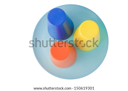 Triple set of colorful plastic cups on a plate isolated on white