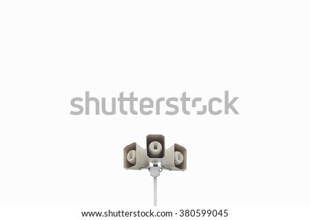 Triple speakers on natural white sky background on a stadium or arena or airport toned photo. Alarm system in a public place - stock photo
