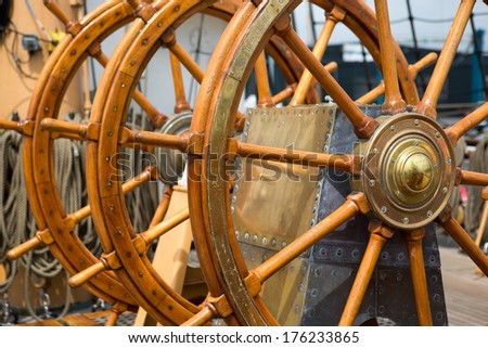 Triple steering wheel on an old military ship. - stock photo