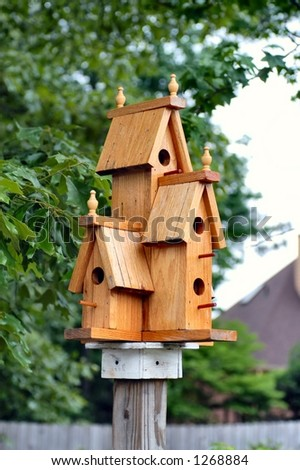 Triple story bird house on a post - stock photo