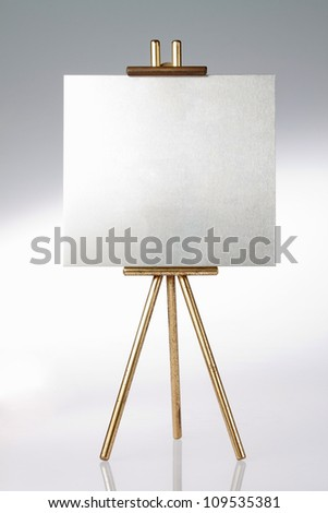 Tripod, easel and blank space. - stock photo