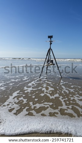 Tripod on the dutch beach - stock photo