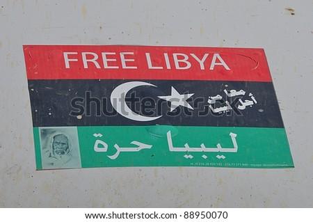 TRIPOLI, LIBYA. 5 NOVEMBER. New flag of Libya to celebrate the liberation from the Qaddafi regime on 5 November 2011 in Tripoli - stock photo