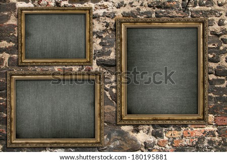 Triptych with empty canvas over ruined brick wall