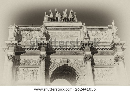 Triumphal Arch (Arc de Triomphe du Carrousel) at Tuileries gardens in Paris, France. Monument was built between 1806 - 1808 to commemorate Napoleon's military victories. Antique vintage. - stock photo