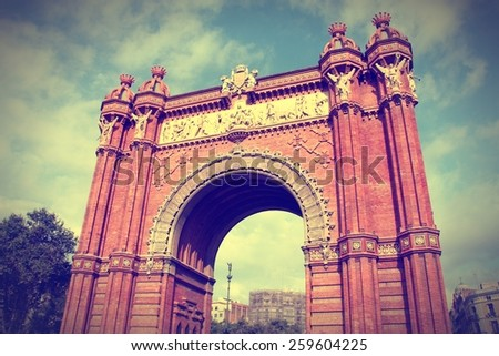 Triumphal Arch - archway structure in Barcelona, Spain. Built by architect Josep Vilaseca i Casanovas. Moorish revival style. Cross processed color tone - retro filtered style. - stock photo