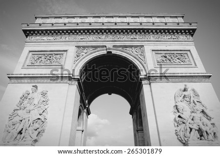 Triumphal Arch in Paris, France. Black and white toned photo. - stock photo