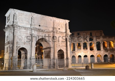 Triumphal Arch of Constantine nearby Colosseum in Rome by night, Italy - stock photo