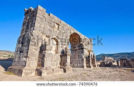 Triumphal Arch - Volubilis features the best preserved Roman ruins in this part of northern Africa. - stock photo