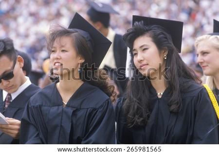 Triumphant graduate, High school graduate,Providence,RI - stock photo