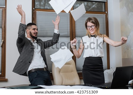Triumphant office worker succeeded in striking a good deal. Happy businessmans - stock photo