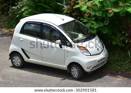 TRIVANDRUM, KERALA, INDIA, AUGUST 02, 2015: The smallest and the cheapest Indian car - Nano from Tata Motors. Small is beautiful. Twist, a full option (power- steering, - window, - brake, a/c) car. - stock photo