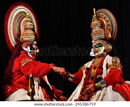 TRIVANDRUM, KERALA, INDIA, JANUARY 19, 2015: Kathakali - the classical dance-drama of Kerala based on Indian mythology, and noted for its elaborate costumes and gestures. Story from Ramayana. - stock photo