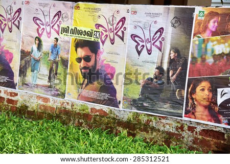 TRIVANDRUM, KERALA, INDIA, JUNE 07, 2015: Movie posters of Premam stuck on the compound wall of a house by the roadside. Actor of Malayalam and Tamil cinema Nivin Pauly seen in the wall posters.