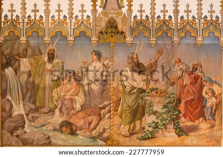 TRNAVA, SLOVAKIA - OCTOBER 14, 2014: Fresco of scene as Moses gets water from rock Passover and offer of the firstborns at the Lords passover by L. Bruckner (1905 - 1906) in Saint Nicholas church.  - stock photo