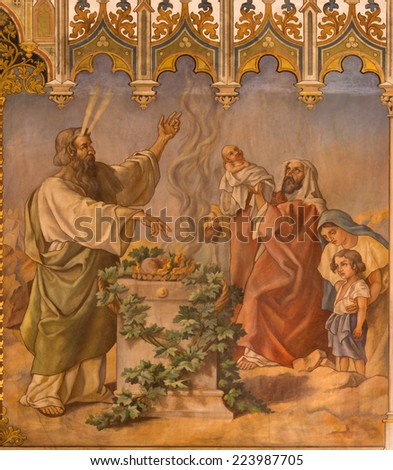 TRNAVA, SLOVAKIA - OCTOBER 14, 2014: The neo-gothic fresco of fhe scene as Moses at Lord�s Passover and offer of the firstborns by Leopold Bruckner (1905 - 1906) in Saint Nicholas church. - stock photo