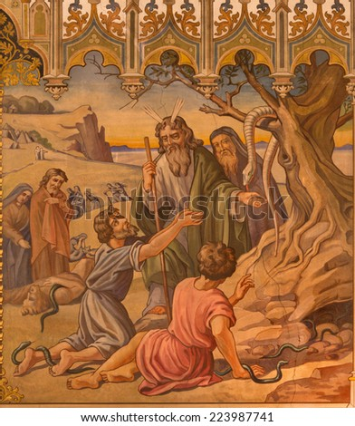 TRNAVA, SLOVAKIA - OCTOBER 14, 2014: The neo-gothic fresco of fhe scene as Moses made a bronze snake by Leopold Bruckner (1905 - 1906) in Saint Nicholas church. - stock photo