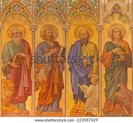 TRNAVA, SLOVAKIA - OCTOBER 14, 2014: The neo-gothic fresco of four  evangelists (Mark,Luke,Matthew,John) by Leopold Bruckner (1905 - 1906) in Saint Nicholas church. - stock photo