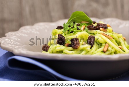 troccoli with rocket pesto, raisins and pine seed