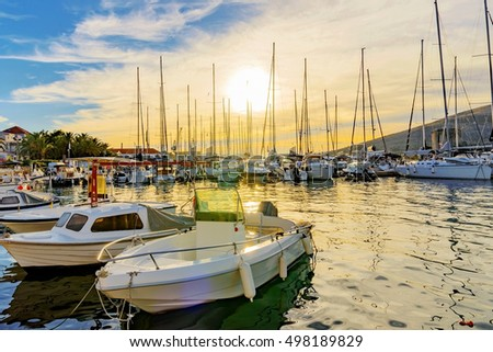 Trogir docks at sunset with boats