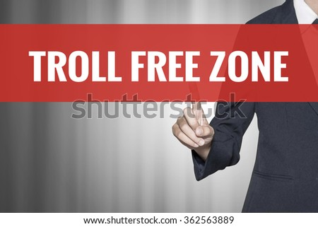 Troll Free Zone word on virtual screen push by business woman red tab - stock photo