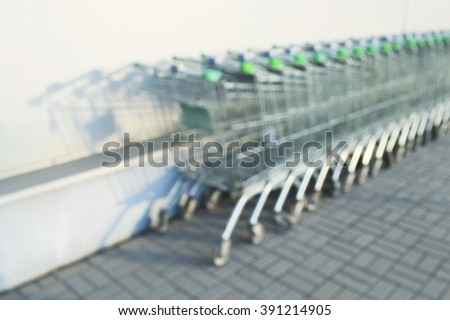 trolley in a supermarket. blurred image - stock photo