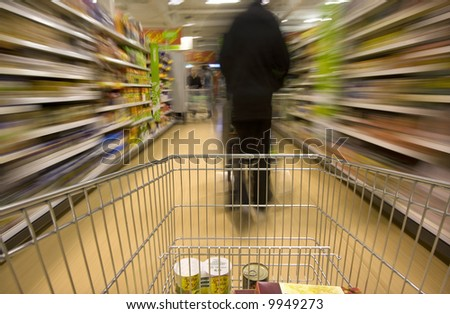 Trolley in supermarket - stock photo