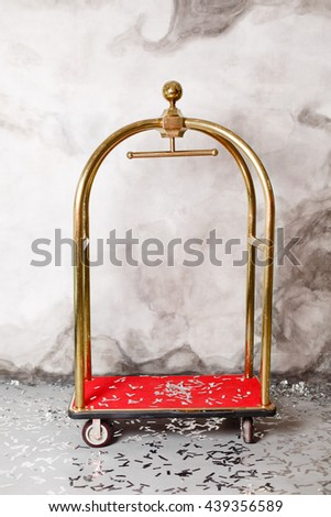 Trolley Luggage on plaster background  - stock photo