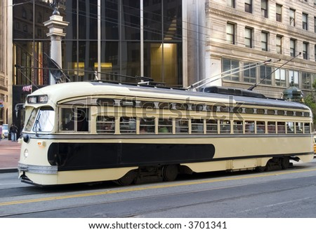 Trolley yellow and brown Public transportation in San Francisco California - stock photo