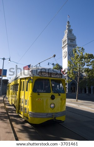 Trolley Yellow with Ferry Building Public transportation in San Francisco California - stock photo