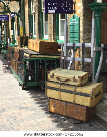 trolleys of cases and trunks at a railway station - stock photo