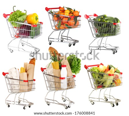 Trolleys with different products isolated on white - stock photo