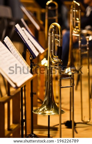 Trombone on the stand on stage closeup - stock photo