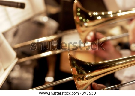 Trombones playing in a big band - shallow focus.