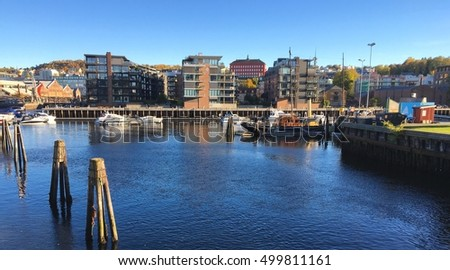 Trondheim, Norway - October 15, 2016: Cityscape of Trondheim with modern living houses standing along the river bank