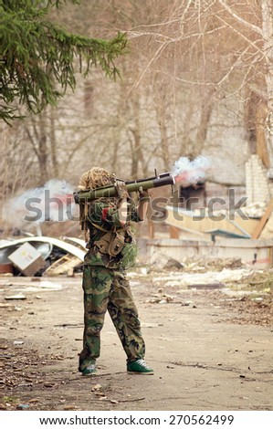 Trooper dresses in camouflage uniform shooting with light anti-tank weapon - stock photo