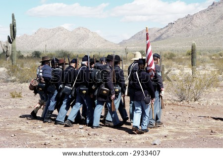 troops marching in a civil war reenactment at Picacho Peak State Park, Arizona - stock photo