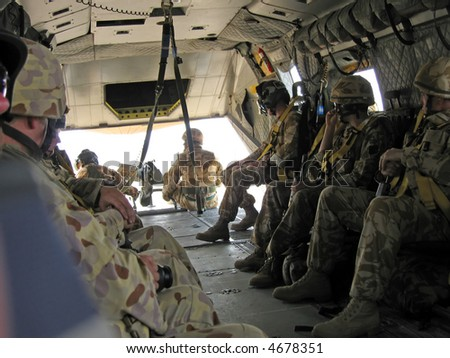Troops sitting in an army helicopter on operations