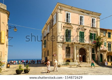 TROPEA, CALABRIA, ITALY - JULY 21: Tourists walking at the historical center of Tropea on July 21, 2013. - stock photo