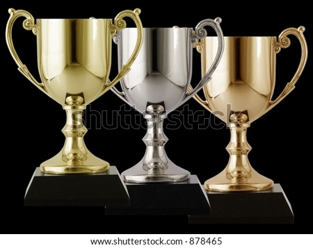 Trophies arranged on a isolated black background - stock photo