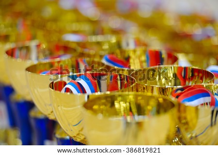 Trophies to winners to award with colored ribbon. - stock photo