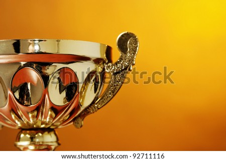 Trophy cup isolated on the orange background - stock photo