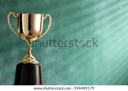 trophy in front of blackboard with light ray effect