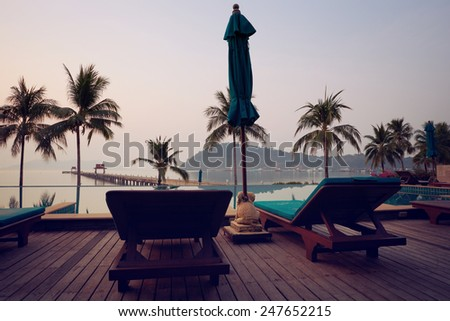 Tropic resort pool against sealine and daybreak light in morning Koh Chang, Thailand  - stock photo