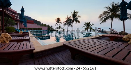 Tropic resort pool against sealine and daybreak light in morning Koh Chang, Thailand Panoramic picture - stock photo